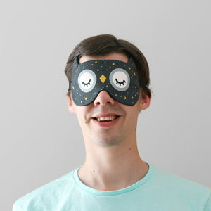 Man wearing night sky owl sleep mask