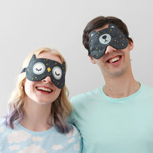 Couple wearing animal eye masks with starry night pattern