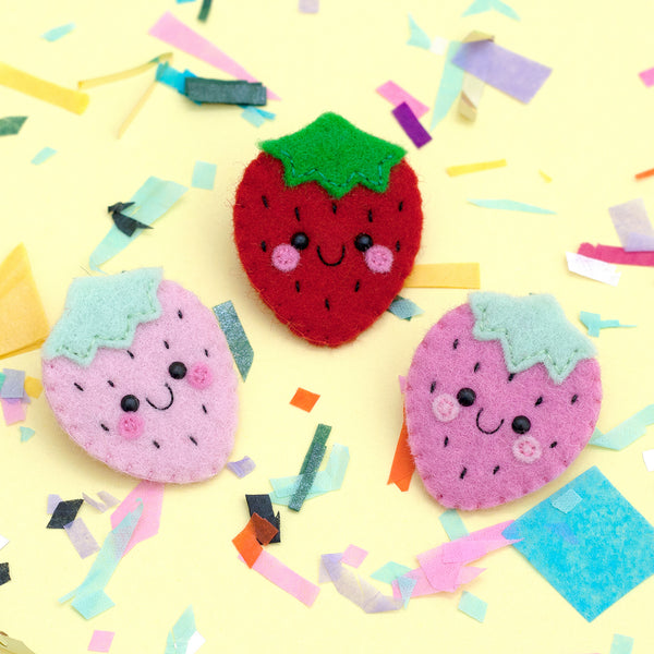 Strawberry felt brooches by hannahdoodle