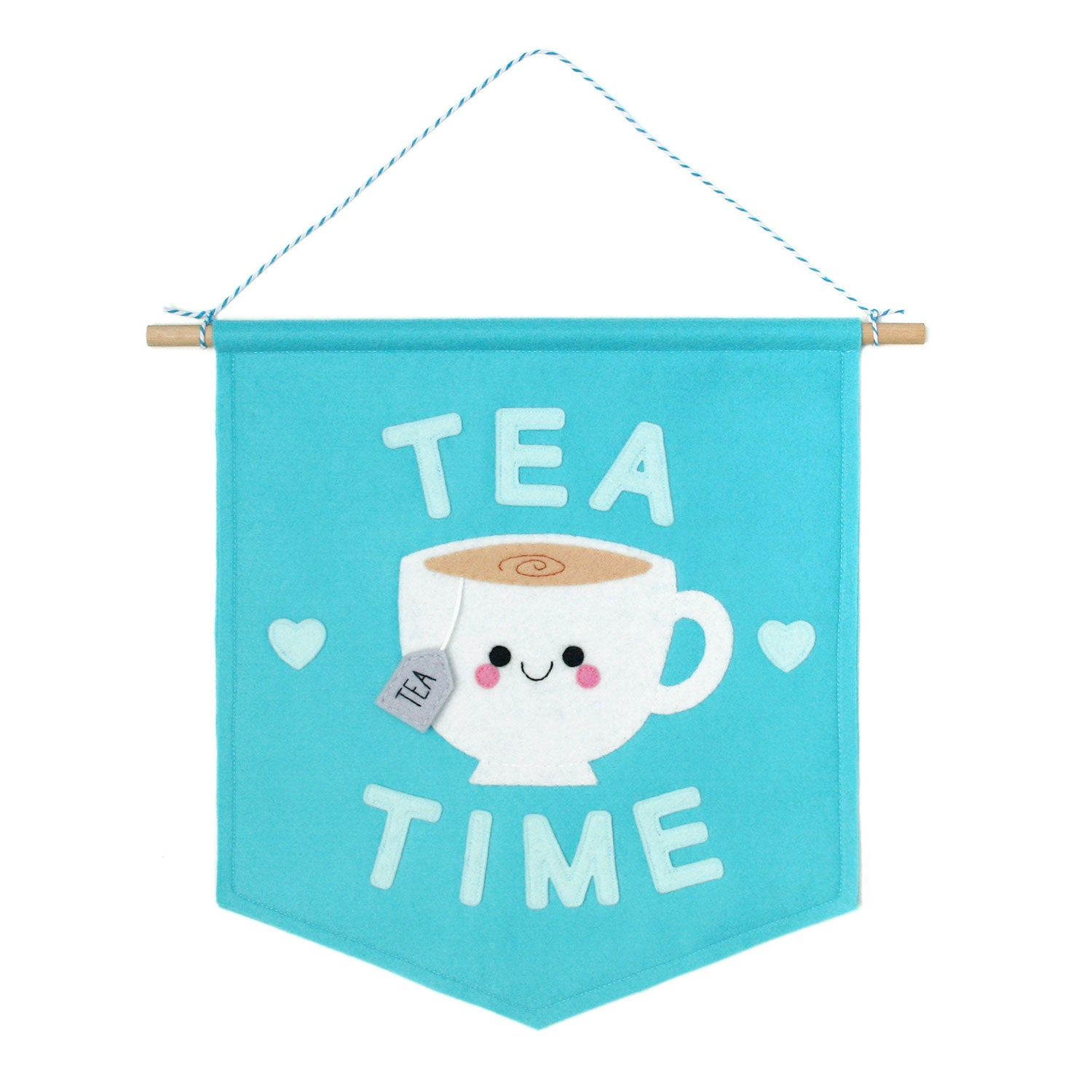 Blue felt banner with a happy teacup and 'TEA TIME' text