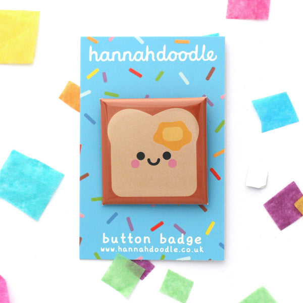 Buttered toast 38mm square button badge attached to blue hannahdoodle backing card