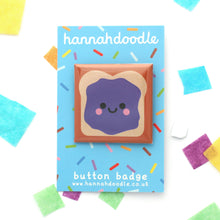 Cute jelly sandwich badge on a blue hannahdoodle branded backing card