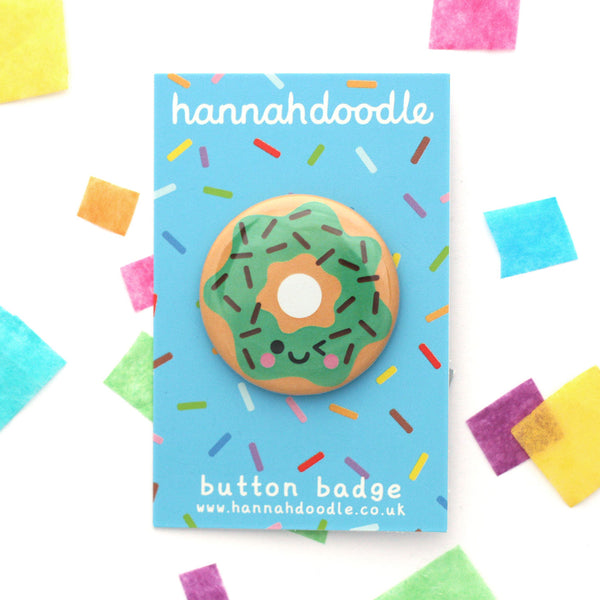 Mint choc chip donut button badge with winking face attached to a hannahdoodle backing card