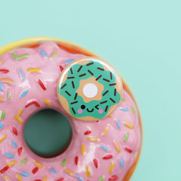 Mint donut button badge on a ceramic donut trinket box