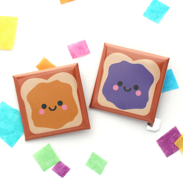 A pair of peanut butter and jelly sandwich badges