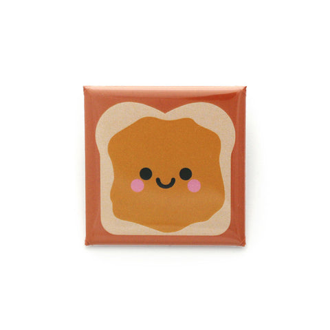 Peanut butter sandwich with smiley face square badge