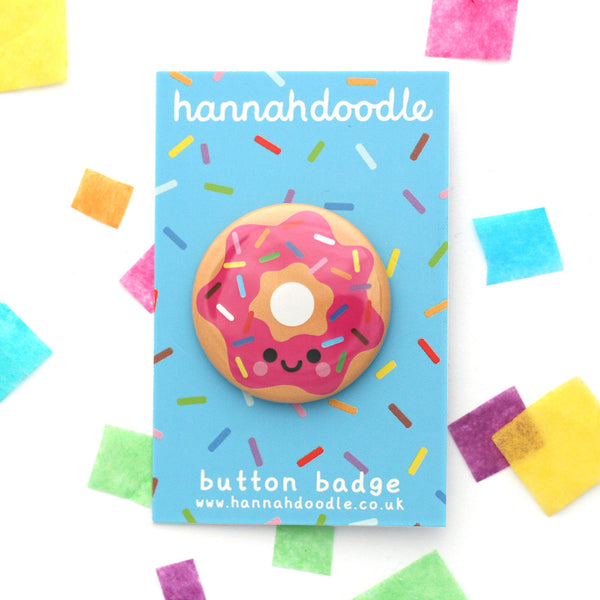 Happy pink donut with rainbow sprinkles 38mm round badge attached to a blue backing card