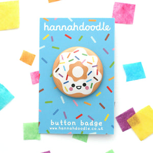 Cute donut button badge with white icing and rainbow sprinkles