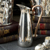 A Silver-Plated Pitcher with Leather Handles - annabeljames