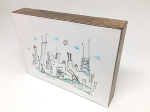 original line drawing by Joe Smigielski drawing of an artist painting in front of Chicago skyline 3x4 inch artwork mounted on woodblock