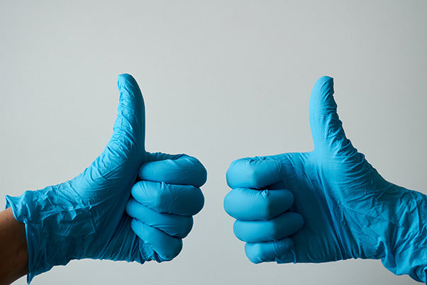 thumbs up with gloves