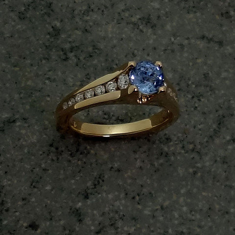 Absolutely  amazing! Our Kirlklie ring cast in 14kt gold and set with a 1.42ct. Blue Sapphire with 10 channel set diamonds at 0.43tcw.  Stunning with an anniversary band also.