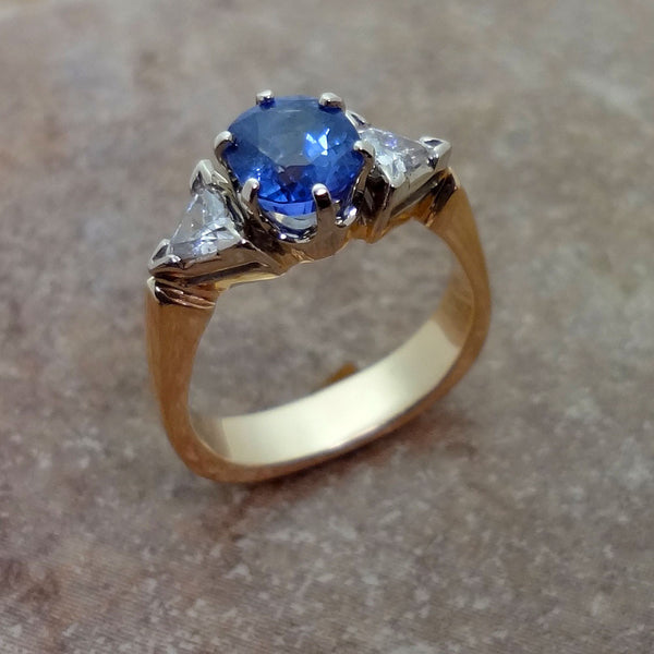 Fine Jewelry Ring with Sapphire and Diamonds set in 14k gold.  Handmade in USA.