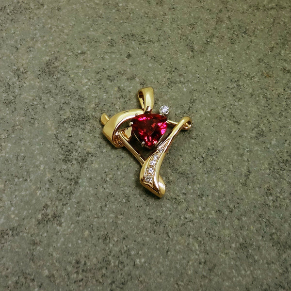 14kt Gold with .15tcw Diamonds surround 3.28 ct Trillion cut magenta Tourmaline pendant.  Handmade in USA.