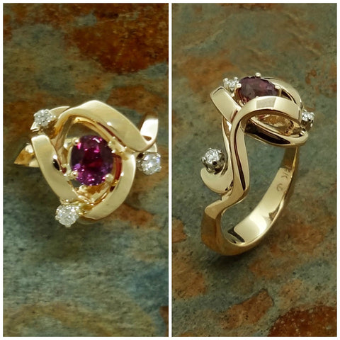 Amazing new Raspberry Pink Sapphire, 1.03ct, ring with three accent Diamonds of 0.15tcw, done in our custom swirl design with a counter balance shank in 14kt gold.