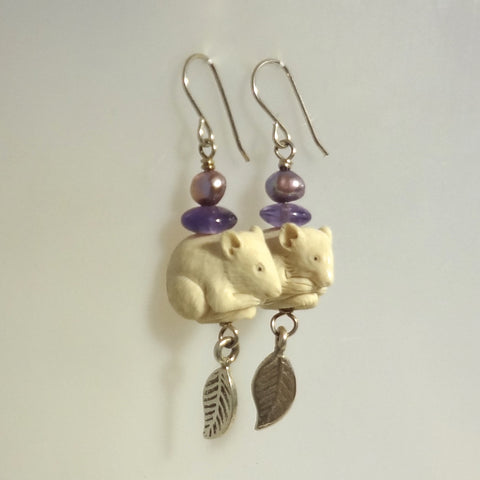 Unique dangle earrings with hand carved mice, amethysts and freshwater pearls.