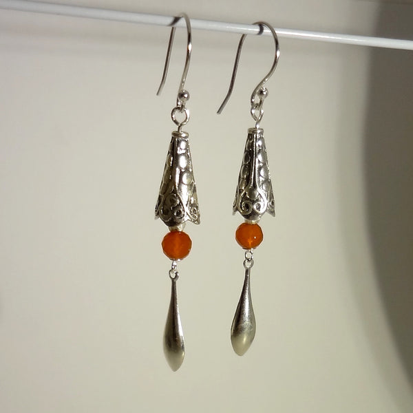 Handmade sterling silver and genuine 6mm carnelian bead dangle earring 2-3/4 inches overall length. $72.  All Animal Jewelry featuring Jan David Design Jewelers.