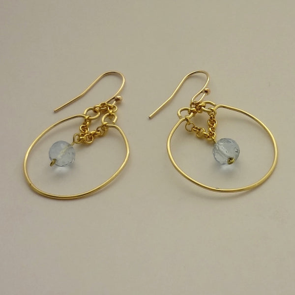 Handmade, one of a kind, gold fill and genuine blue topaz earring.  1 1/2 inch overall length.  $47.  All Animal Jewelry featuring Jan David Design Jewelers.