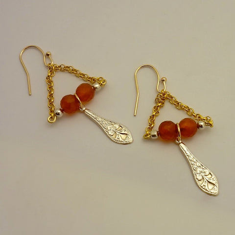 Handmade pretty dangles.  Genuine handout carnelian beads.  Sterling silver beads and dangle.  Gold fill shepherd hook ear wires and chain.  Brass wire.  Jan David Design Jewelers and All Animal Jewelry.