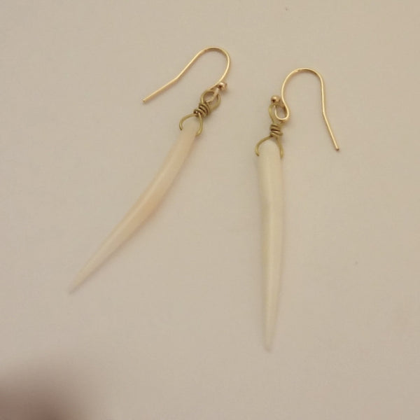 Handmade, white/angelskin coral hand polished spears. Pretty dangles. Almost 2.5 inches in overall length.  Handmade wire wrap.  Jan David Design Jewelers for All Animal Jewelry.