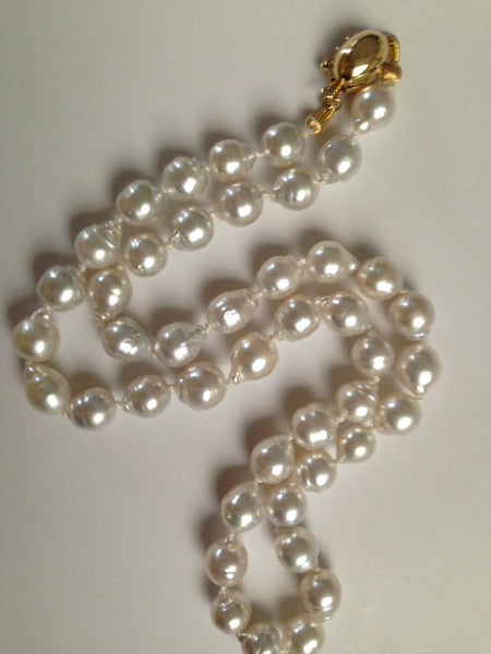 Beautiful cultured baroque shape pearl strand with 14k gold clasp