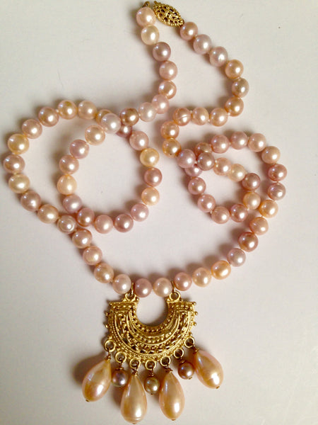 Beautiful and different, cultured pearl strand with Medallion and Pearl Dangles