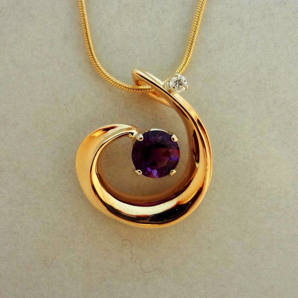 1.28ct Zambian Amethyst set in a 14kt gold swirl with a 0.07ct. Diamond accent at the top.