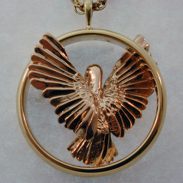 Rose Gold Pelican also available in Sterling or 14k gold  handmade in Sterling or 14k gold by Tosa Fine Jewelry