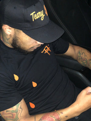 Black and orange Teary Eyez tee.