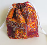 Orange Australian aboriginal art print cotton drawstring bag or knitting project bag.
