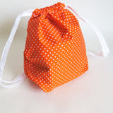 Orange and white polka dots print cotton drawstring bag or knitting project bag.