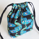 Peacock gold on black print cotton drawstring bag or knitting project bag.
