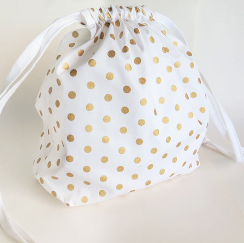 White and gold polka dot cotton drawstring bag or knitting project bag.