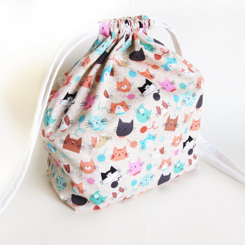 Beige Cats and Yarn balls print cotton drawstring bag or knitting project bag.
