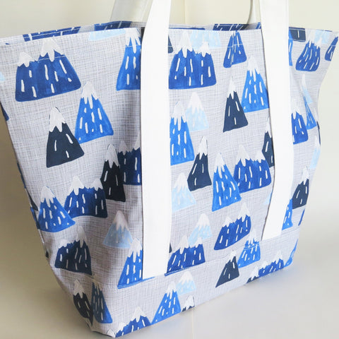 Snow-capped mountains tote bag