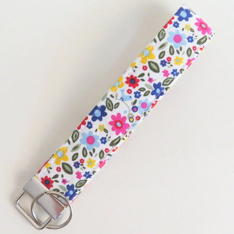 Colorful flowers and a little birdie key fob