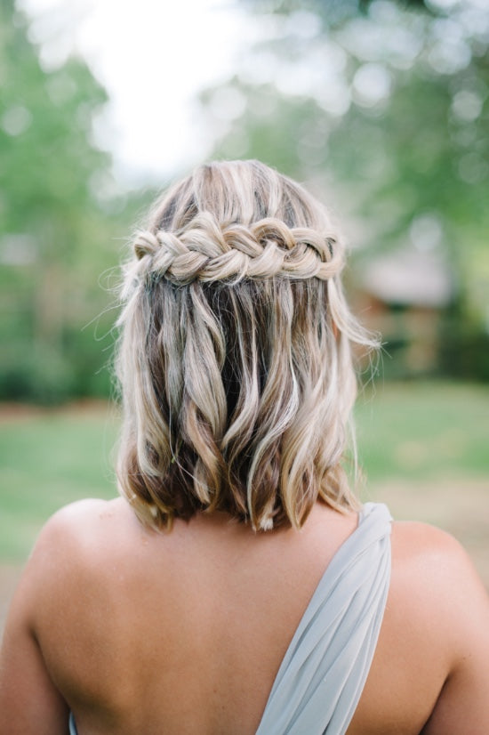 medium hair half up half down braided bridesmaid hairstyle