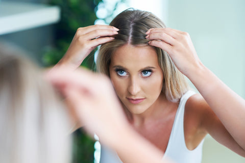 woman brushing hair with comb