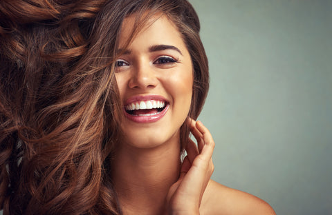 Young woman laughing smiling hair blowing beauty healthy wellness long hair