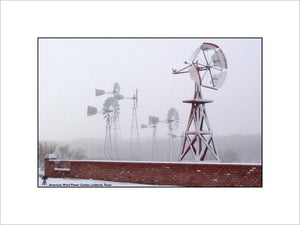 Snow Covered Windmill and Fence