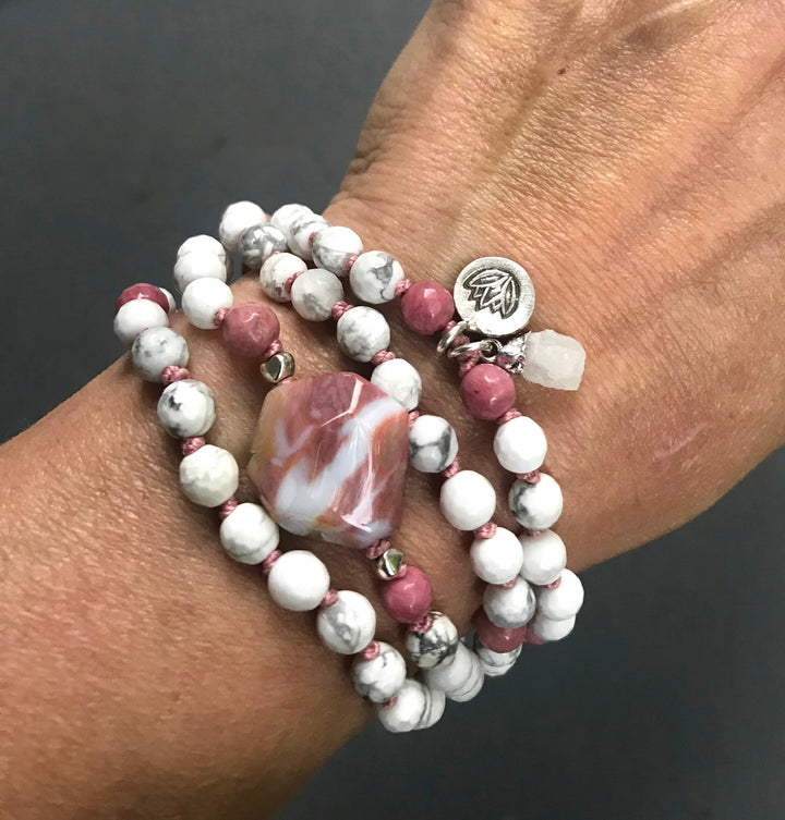 Calm the Mind and Release Negativity with this 108 Knotted Howlite and Rhodonite Mala Bracelet finished with a Raw Quartz and Om charm
