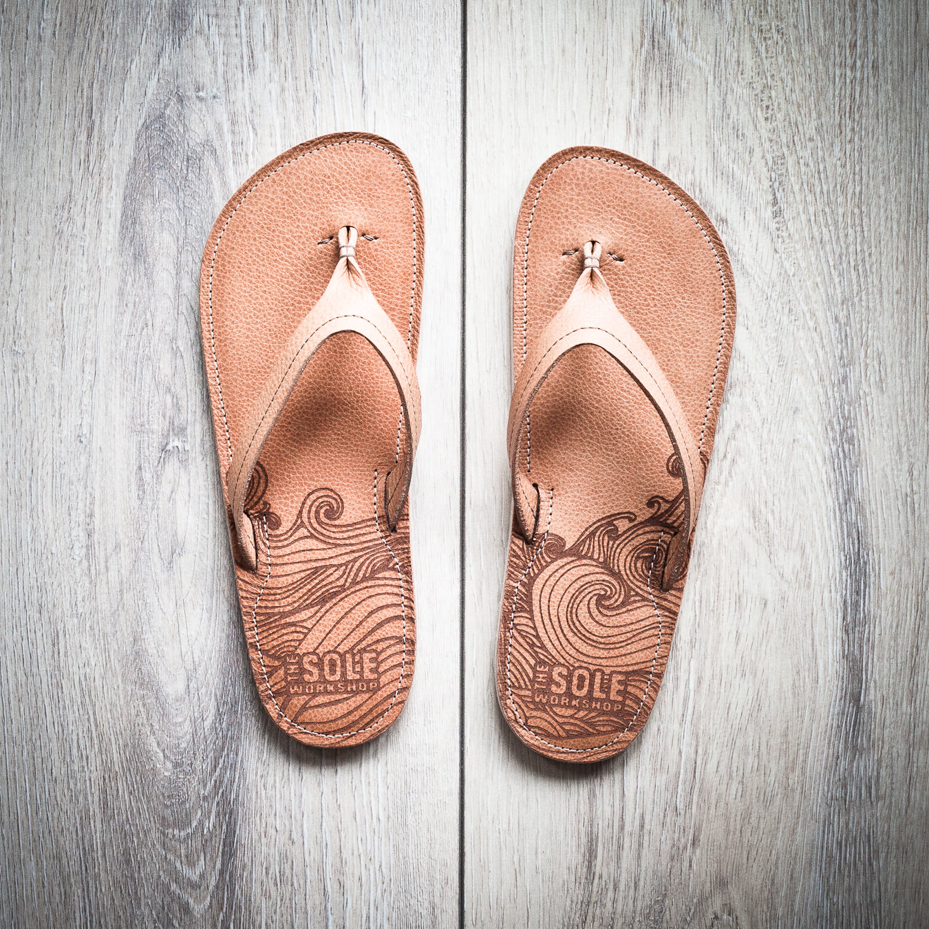 Custom wave pattern engraved on leather sandals.