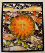 Fused glass sun face in stained glass panel