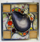 Stained glass panel with Brazilian agate slice.