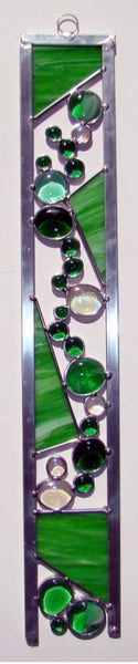 Large 24 inch stained glass sun catcher we call a Color Strip which contains glass nuggets and stained glass lined with zinc.  Ready to hang with ring on top.