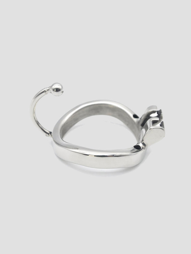 An additional steel chastity cage ring
