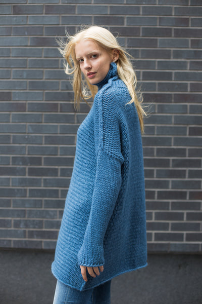 Woman knit oversize sweater dress.