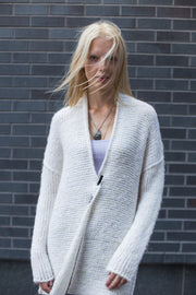 White alpaca knit cardigan.