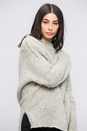 Light grey alpaca oversized woman knit sweater.