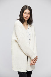 Oversized chunky knit woman cardigan.